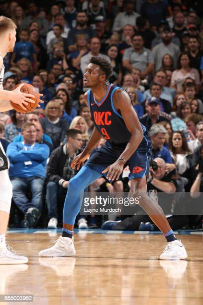 Jerami Grant of the Oklahoma City Thunder guards against the San Antonio Spurs on December 3 2017 at Chesapeake Energy Arena in Oklahoma City...