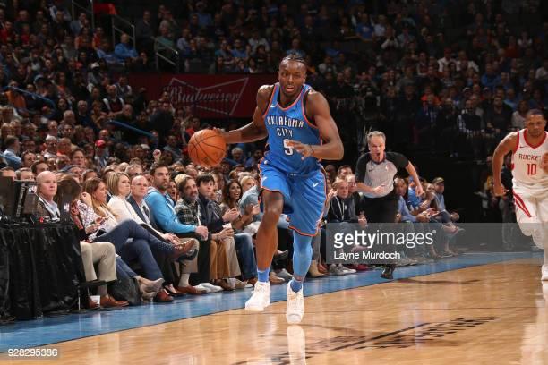 Jerami Grant of the Oklahoma City Thunder handles the ball against the Houston Rockets on March 6 2018 at Chesapeake Energy Arena in Oklahoma City...