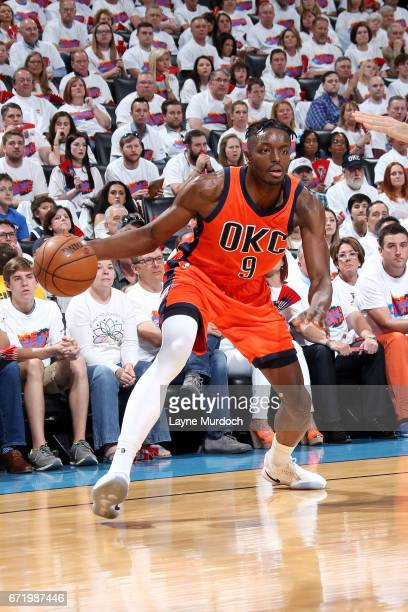 Jerami Grant of the Oklahoma City Thunder handles the ball during the game against the Houston Rockets in Game Four during the Western Conference...