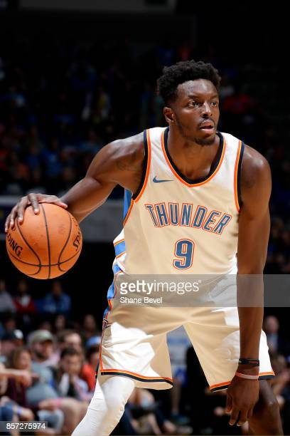 Jerami Grant of the Oklahoma City Thunder handles the ball during the preseason game against the Houston Rockets on October 3 2017 at the BOK Center...