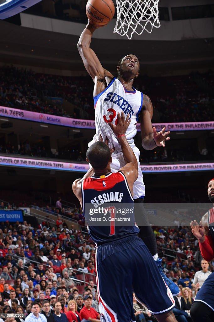 Jerami Grant #39 of the Philadelphia 76ers posterizes Ramon Sessions #7 of the Washington Wizards at Wells Fargo Center on April 8, 2015 in Philadelphia, Pennsylvania
