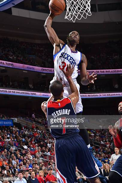 Jerami Grant of the Philadelphia 76ers posterizes Ramon Sessions of the Washington Wizards at Wells Fargo Center on April 8 2015 in Philadelphia...