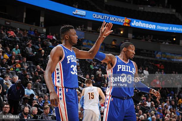 Jerami Grant of the Philadelphia 76ers shakes hands with Robert Covington of the Philadelphia 76ers during the game against the Denver Nuggets on...