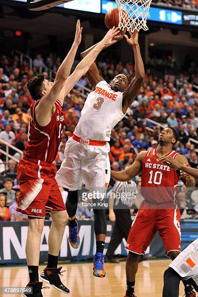 Jerami Grant of the Syracuse Orange goes to the hoop against Jordan Vandenberg of the North Carolina State Wolfpack during the quarterfinals of the...