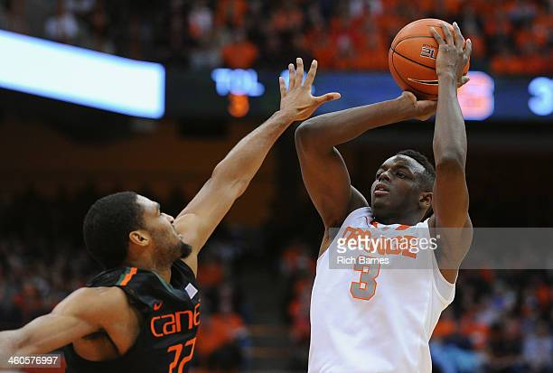 Jerami Grant of the Syracuse Orange takes a shot over Donnavan Kirk of the Miami Hurricanes during the second half at the Carrier Dome on January 4...