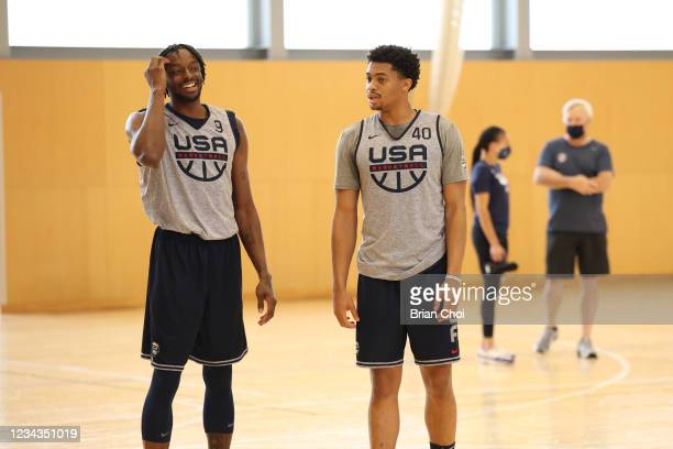 Jerami Grant of the USA Men's National Team talks with Keldon Johnson of the USA Men's National Team during USAB Mens National Team practice on July...