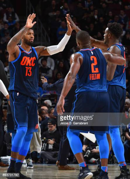 Jerami Grant Paul George and Raymond Felton of the Oklahoma City Thunder give each other high fives against the Philadelphia 76ers at Wells Fargo...