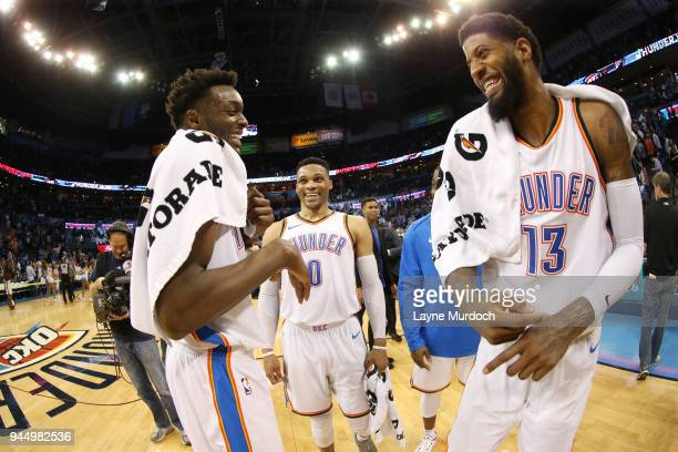 Jerami Grant Russell Westbrook and Paul George of the Oklahoma City Thunder celebrate on April 11 2018 at Chesapeake Energy Arena in Oklahoma City...