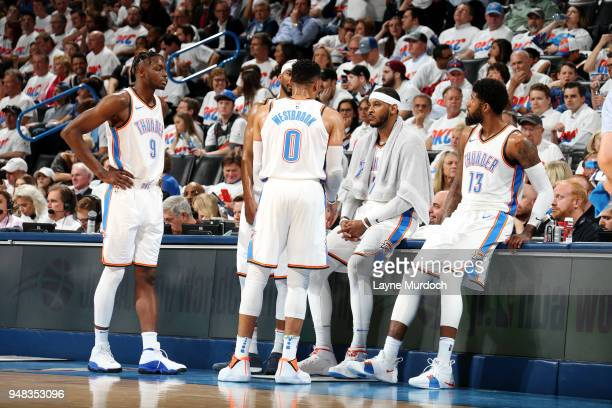 CITY OK APRIL 18 Jerami Grant Russell Westbrook Carmelo Anthony and Paul George of the Oklahoma City Thunder huddle in Game Two of Round One of the...