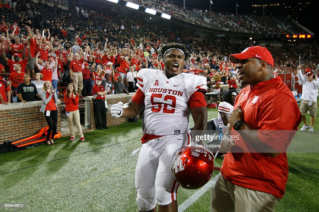 Jerard Carter #52 of the Houston Cougars celebrates along with fans after an interception return for a touchdown by Howard Wilson in the fourth quarter against the Cincinnati Bearcats at Nippert Stadium on September 15, 2016 in Cincinnati, Ohio. Houston defeated Cincinnati 40-16.