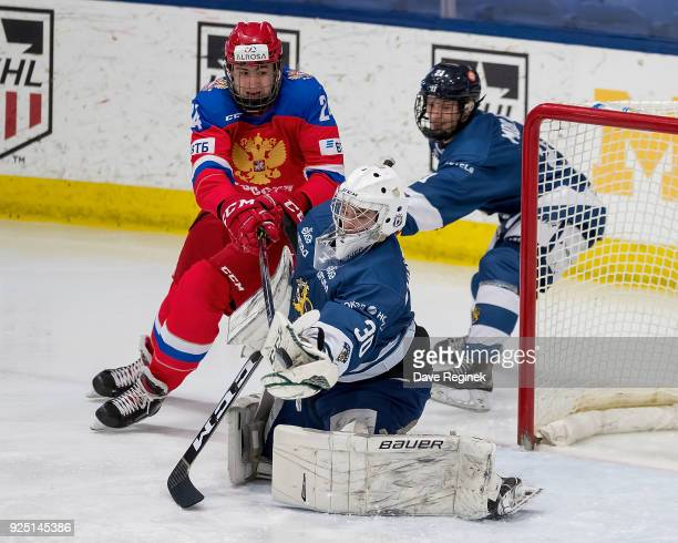 Jere Huhtamaa of the Finland Nationals makes a glove save in front of Yegor Sokolov of the Russian Nationals during the 2018 Under18 Five Nations...