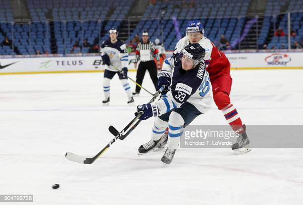 Jere Innala of Finland shoots the puck against the Czech Republic during the second period of play in the IIHF World Junior Championships...