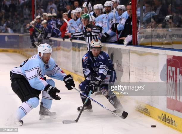 Jere Karalahti of Hamburg challenges Kris Sparre of Iserlohn during the DEL match between Hamburg Freezers and Iserlohn Roosters at the Color Line...