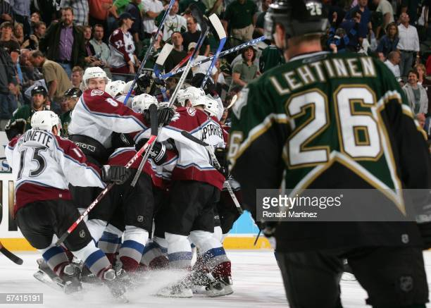 Jere Lehtinen of the Dallas Stars watches Wojtek Wolski Andrew Brunette and the Colorado Avalanche celebrate after the score the game winning goal in...