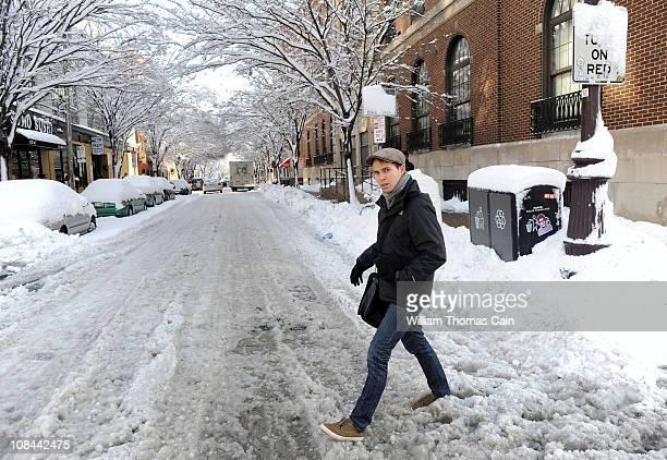 Jere Mahaffur of Birmingham Alabama crosses a slushy street January 27 2011 in Philadelphia Pennsylvania The Philadelphia region was covered in...