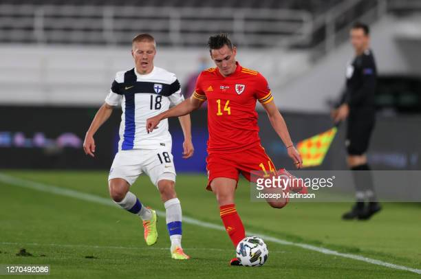 Jere Uronen of Finland battles for possession with Connor Roberts of Wales during the UEFA Nations League group stage match between Finland and Wales...