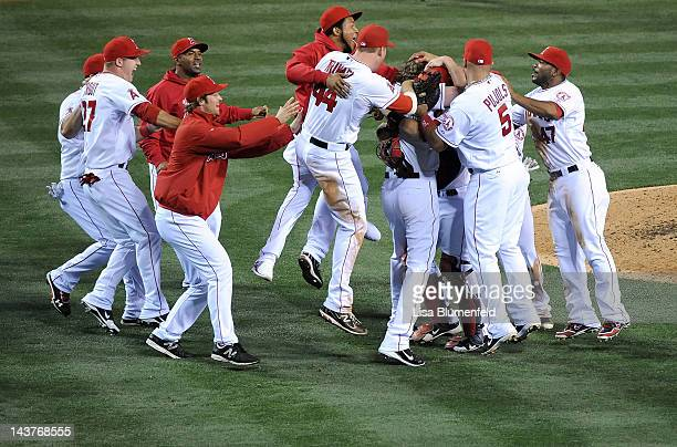 Jered Weaver of the Los Angeles Angels of Anaheim celebrates with his teammates after throwing a nohitter to defeat the Minnesota Twins 90 at Angel...