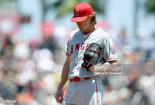 Jered Weaver of the Los Angeles Angels of Anaheim looks down at the ground after giving up a solo home run to Joe Panik of the San Francisco Giants...