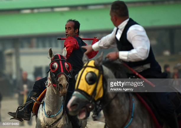 Jereed players from Erzurum Farm Sport Club are seen on their horses as they perform a ceremonial jereed game during a ceremony in Toroslar town of...