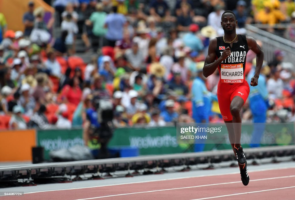 TOPSHOT - Jereem Richards of Trinidad and Tobago competes in the athletics men's 200m heats during the 2018 Gold Coast Commonwealth Games at the Carrara Stadium on the Gold Coast on April 10, 2018. /
