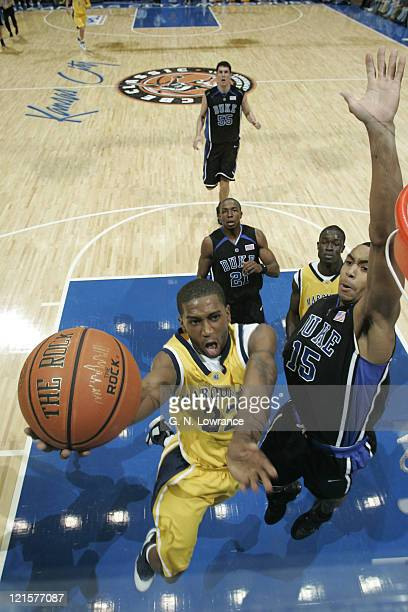 Jerel McNeal of Marquette drives in for a basket during the annual CBE Classic championship game between Marquette and Duke at Municipal Auditorium...