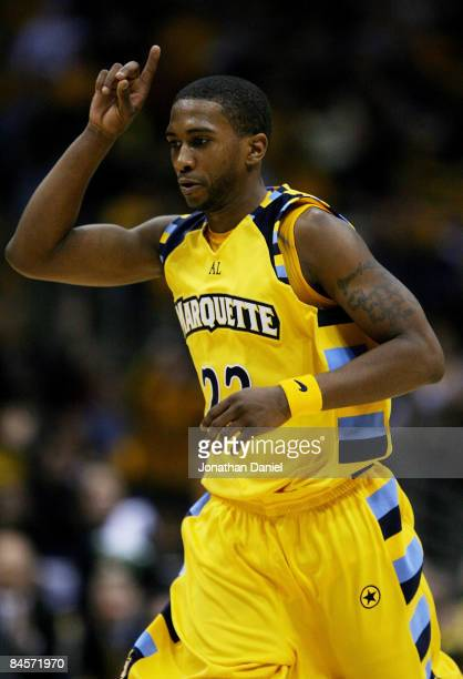 Jerel McNeal of the Marquette Golden Eagles celebrates hitting a three-point shot as he runs down the court against the Georgetown Hoyas on January...