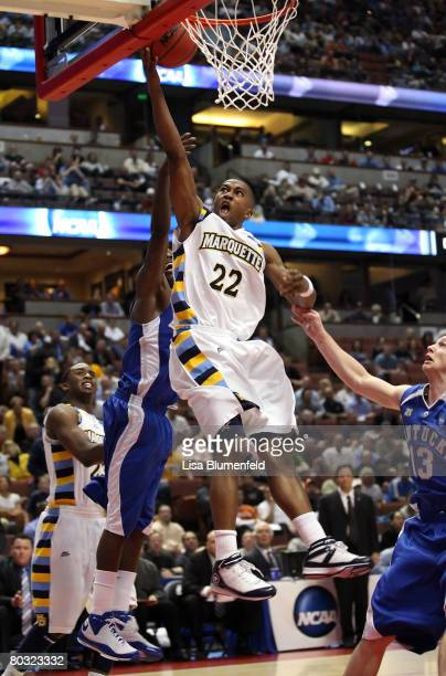 Jerel McNeal of the Marquette Golden Eagles drives to the basket over the defense of the Kentucky Wildcats during the South Region first round of...