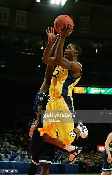 Jerel McNeal of the Marquette Golden Eagles drives to the hoop against the Georgetown Hoyas during the quarterfinals of the Big East Men's Basketball...