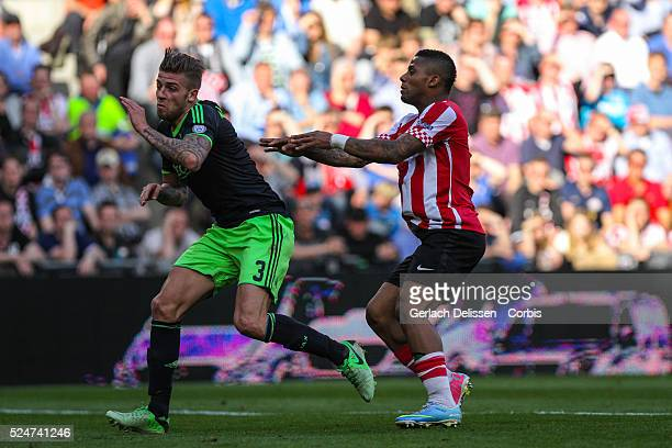 Jeremain Lens giving a hard push towards Toby Alderweireld during the match PSV-AJAX played in Eindhoven on April 14th 2013.