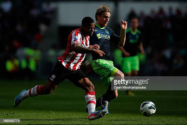 Jeremain Lens of PSV and Christian Poulsen of Ajax battle for the ball during the Eredivisie match between PSV Eindhoven and Ajax Amsterdam at...