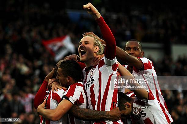 Jeremain Lens of PSV is congratulated by team mates after he scores the third goal of the game with captain Ola Toivonen screaming towards the fans...