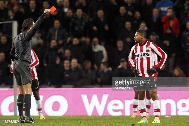 Jeremain Lens of PSV referee Bas Nijhuis during the Eredivisie match between PSV Eindhoven and NAC Breda at the Philips stadium on December 10 2011...