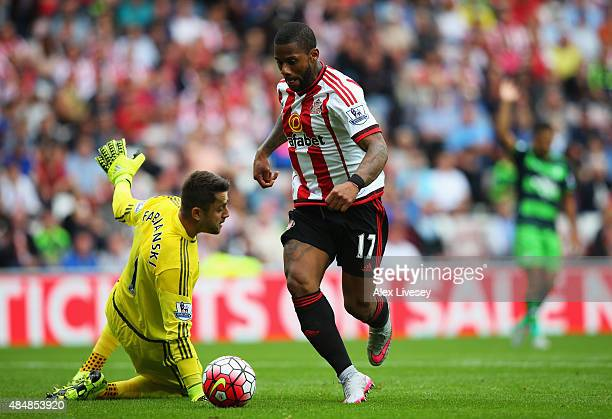Jeremain Lens of Sunderland and Lukasz Fabianski of Swansea City compete for the ball during the Barclays Premier League match between Sunderland and...