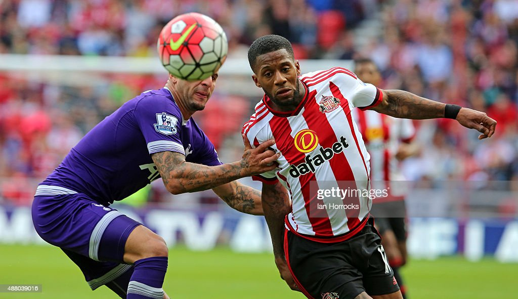 Jeremain Lens of Sunderland (R) battles with Kyle walker of Tottenham (L) during the Barclays Premier League match between Sunderland and Tottenham Hotspur at the Stadium of Light on September 13, 2015 in Sunderland, England.