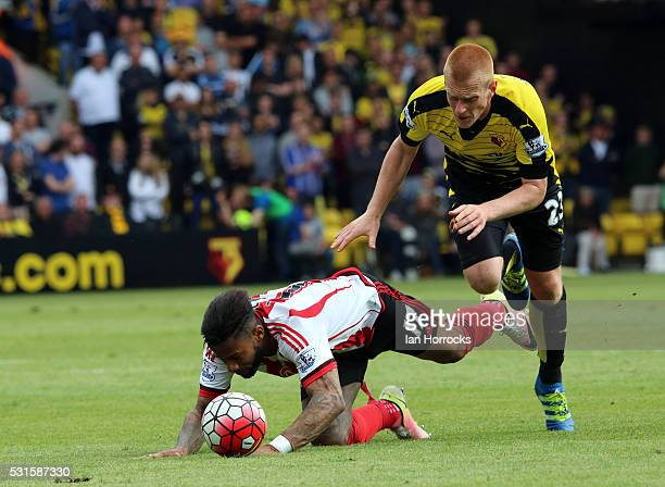 Jeremain Lens of Sunderland is brought down by Ben Watson of Watford during the Barclays Premier League match between Watford and Sunderland at...