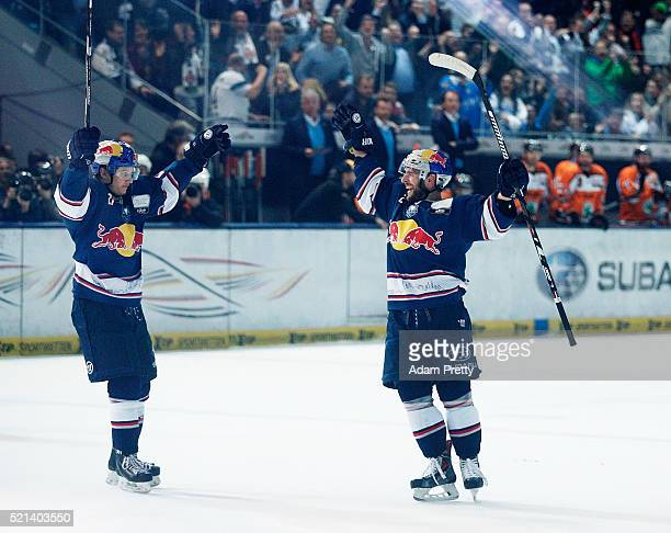 Jeremey Dehner of Red Bull Muenchen celebrates scoring the winning goal during the DEL Ice Hockey Playoffs Final Game One between EHC Red Bull...