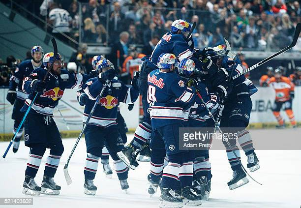 Jeremey Dehner of Red Bull Muenchen is congratulated after scoring the winning goal during the DEL Ice Hockey Playoffs Final Game One between EHC Red...