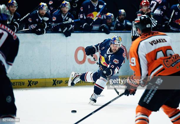 Jeremey Dehner of Red Bull Muenchen scores the winning goal during the DEL Ice Hockey Playoffs Final Game One between EHC Red Bull Muenchen and...