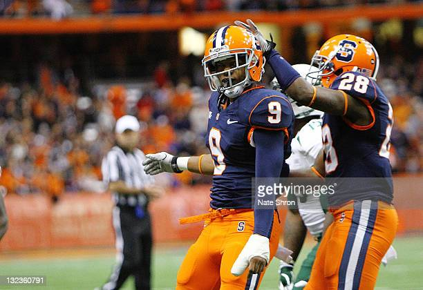 Jeremi Wilkes of the Syracuse Orange celebrates with teammate Ri'Shard Anderson during the game against the South Florida Bulls at the Carrier Dome...