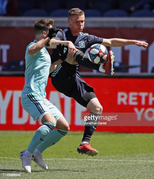 Jeremiah Gutjahr of Chicago Fire tries to control the ball against Keegan Rosenberry of Colorado Rapids at SeatGeek Stadium on April 20, 2019 in...