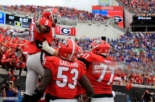 Jeremiah Holloman of the Georgia Bulldogs celebrates a touchdown during a game against the Florida Gators at TIAA Bank Field on October 27 2018 in...