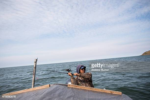 Jeremiah John fishes for salmon on July 1 2015 in Newtok Alaska Newtok has a population of approximately of 375 ethnically Yupik people and was...