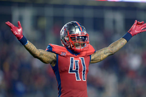 Jeremiah Johnson of the Houston Roughnecks pumps up the crowd during the XFL game against the St Louis BattleHawks at TDECU Stadium on February 16...