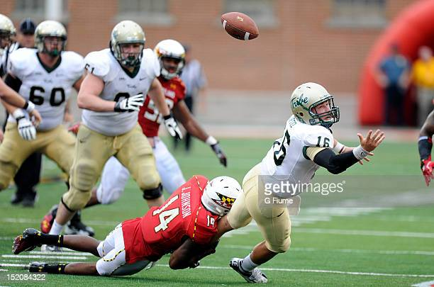 Jeremiah Johnson of the Maryland Terrapins forces a fumble by Raphael Ortiz of the William Mary Tribe at Byrd Stadium on September 1 2012 in College...