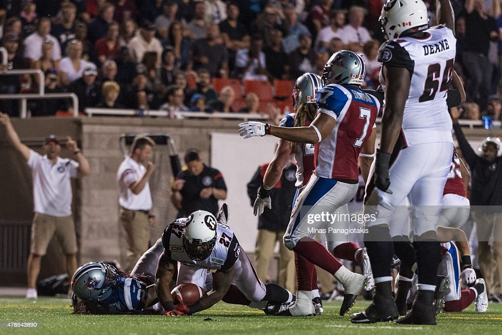 Jeremiah Johnson #27 of the Ottawa Redblacks scores a touchdown during the CFL game against the Montreal Alouettes at Percival Molson Stadium on June 25, 2015 in Montreal, Quebec, Canada. The Ottawa Redblacks defeated the Montreal Alouettes 20-16.