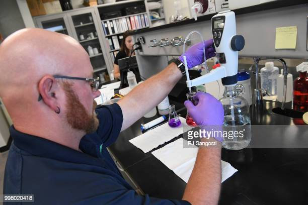Jeremiah Lane, water systems operator with South Adams County Water and Sanitation District, work in the lab testing water at Klein Water Treatment...