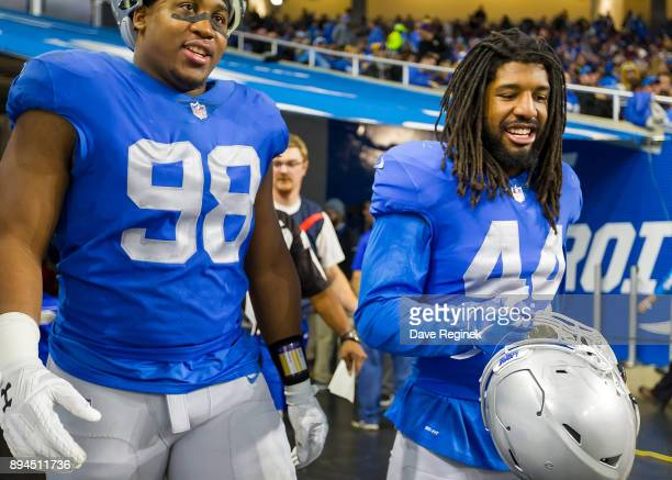 Jeremiah Ledbetter and Jalen Reeves-Maybin of the Detroit Lions head back out to the field to start the second half against the Minnesota Vikings...