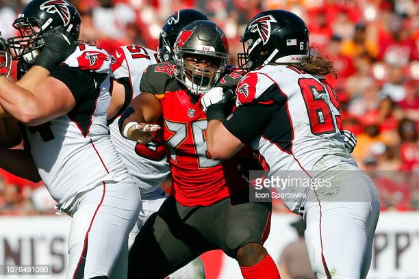 Jeremiah Ledbetter of the Bucs rushes the passer during the regular season game between the Atlanta Falcons and the Tampa Bay Buccaneers on December...