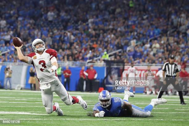 Jeremiah Ledbetter of the Detroit Lions attempts to tackle Carson Palmer of the Arizona Cardinals in the first half at Ford Field on September 10...