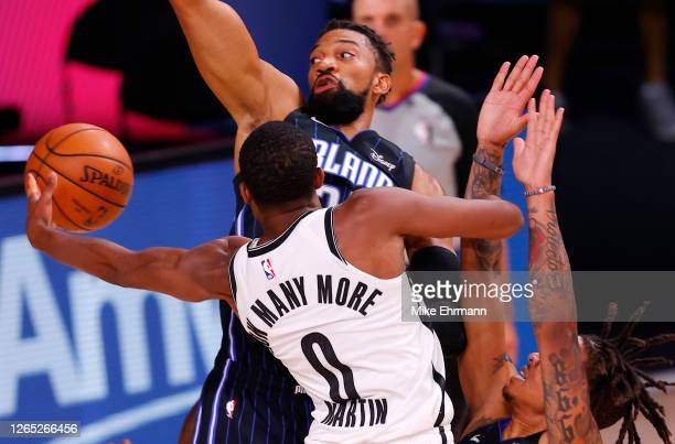 Jeremiah Martin of the Brooklyn Nets goes up for a shot against Khem Birch and Markelle Fultz of the Orlando Magic during the second half at...